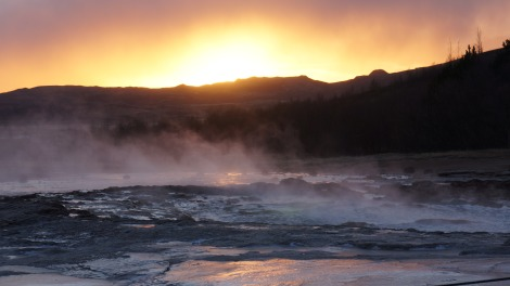 - strokkur hot springs and geyser at sunset -