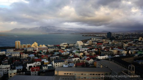 - aerial view of reykjavik with the esja volcano mountain in the background -