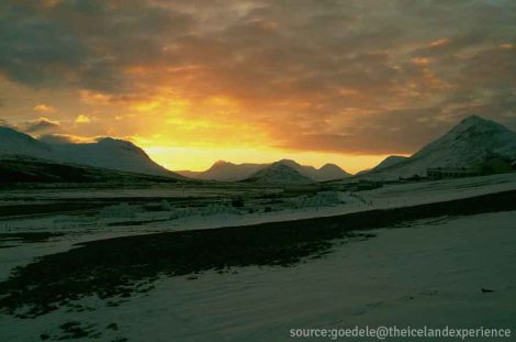 - a gorgeous sunset laces the snow-capped landscape -