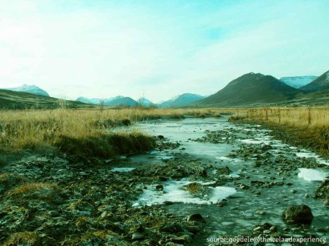 - a stream flows along another scenic landscape here in iceland -